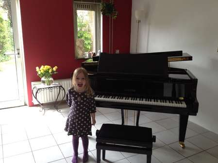 My_daughter_in_front_of_the_piano..jpg