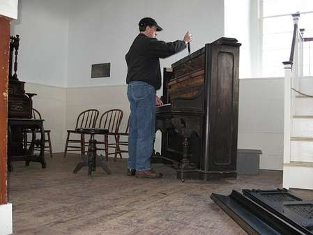 "Here I am, ""tuning"", after setting the camera on a cold pew, setting the timer for 10 seconds, running back to the piano, grabbing the tuning hammer...click!"